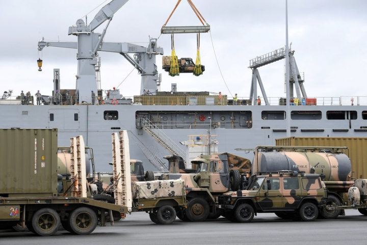 Emergency relief supplies for those affected by Cyclone Debbie are loaded onto the Royal Australian Navy Ship HMAS Choules at the Port of Brisbane in Australia, March 29, 2017.   AAP/Dave Hunt/via REUTERS