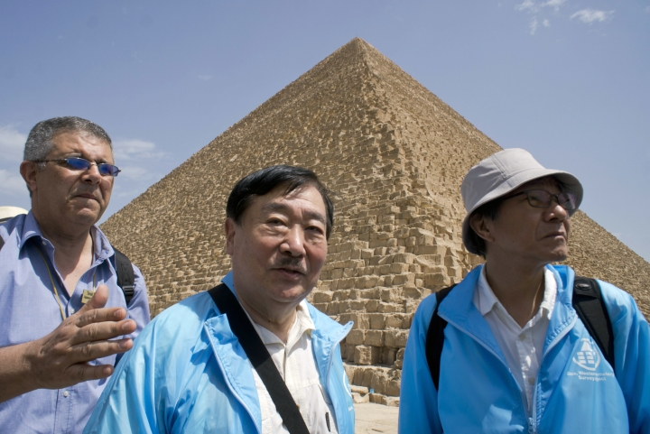 Sakuji Yoshimura, the director of the Institute of Egyptology, Waseda University, center, leaves the site of Cheops' second solar boat below the Pyramids site in Giza, Egypt, Wednesday, March 29, 2017. Egypt is inaugurating its largest on-site antiquities laboratory, to restore the second ceremonial boat of Pharaoh Cheops, known for building the largest of Egypt's iconic pyramids. The project, funded by the Japan International Cooperation Agency and the Higashi Nippon International University, is set to complete the initial phase of repairs of the 4,500-year-old vessel by 2020. (AP Photo/Amr Nabil)