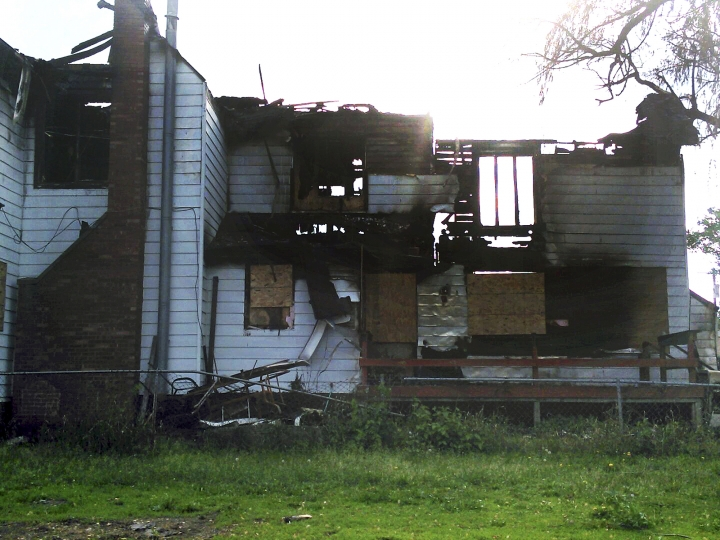 This 2014 photo provided by Jaclyn Bentley' shows the burned remains of her home in Clinton, Iowa. Bentley was acquitted in February 2017 of arson and insurance fraud charges, which she said stemmed from a flawed analysis of cellphone tower records. (Jaclyn Bentley via AP)
