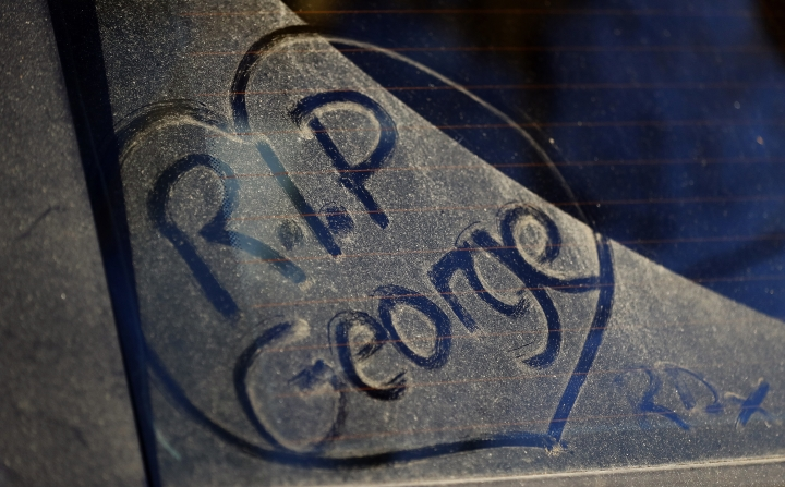 FILE - In this file photo dated Tuesday, Dec. 27, 2016, a message written by a fan on a dusty car window outside the home of British musician George Michael in London. A private funeral took place Wednesday March 29, 2017, at Highgate Cemetery, north London, according to a statement released by Michael's publicity agency, Connie Filippello Publicity, saying the funeral was attended by family and close friends. (AP Photo/Frank Augstein, FILE)