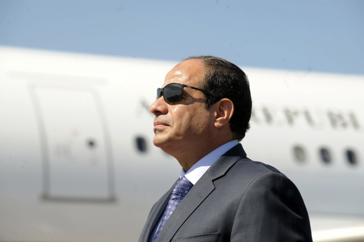 FILE - In this June 25, 2014, file photo, Egyptian President Abdel-Fattah el-Sissi stands at Algiers airport on his arrival to Algiers, Algeria. Making his first official visit to Washington since taking office in 2014, Abdel-Fattah el-Sissi's meeting this week with U.S. President Donald Trump would be a significant step in the international rehabilitation of the general-turned-politician who was kept out of the Obama White House. (AP Photo/Sidali Djarboub, File)