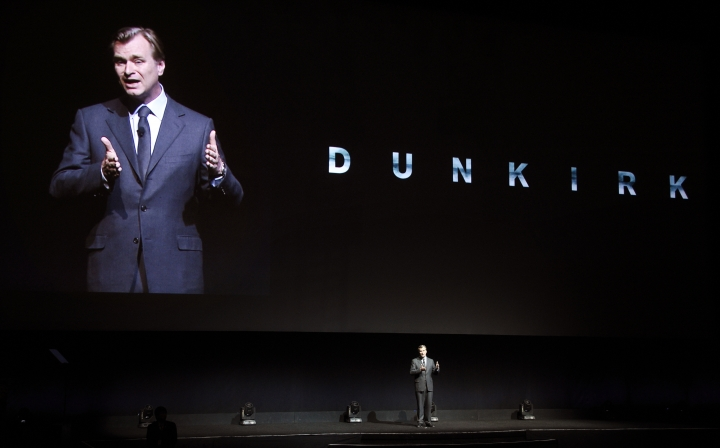 """FILE - In this Wednesday, March 29, 2017, file photo, Christopher Nolan, director of the upcoming film """"Dunkirk,"""" discusses the film onstage during the Warner Bros. Pictures presentation at CinemaCon 2017 at Caesars Palace in Las Vegas. His latest film, """"Dunkirk"""" takes him out of the fantasy world and into reality and the evacuation of the Allied soldiers from that beach in France in May and June of 1940. Nolan spoke to The Associated Press about """"Dunkirk,"""" which sails into theaters on July 21. (Photo by Chris Pizzello/Invision/AP, File)"""