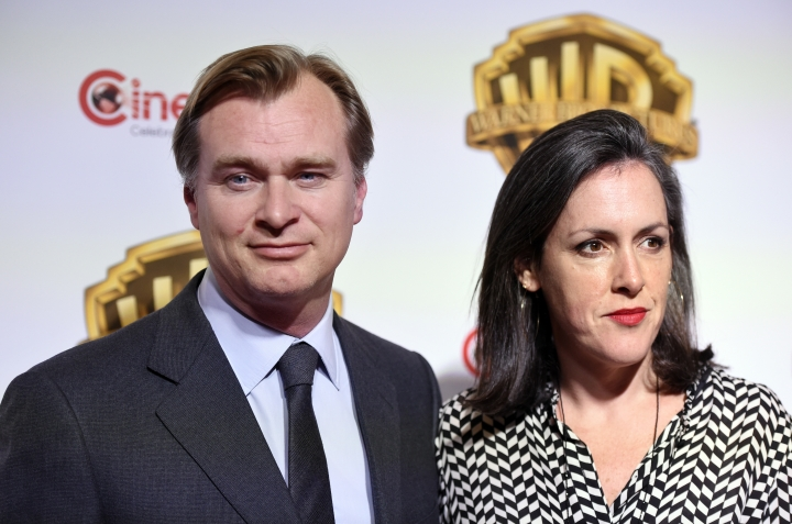 "FILE - In this March 29, 2017 file photo, Christopher Nolan, director of the upcoming film ""Dunkirk,"" poses with his wife and the film's producer Emma Thomas, before the Warner Bros. Pictures presentation at CinemaCon 2017 in Las Vegas. Nolan's latest film, ""Dunkirk,"" in theaters on July 21, takes him out of the fantasy world and into reality and the evacuation of the Allied soldiers from that beach in France in May and June of 1940. (Photo by Chris Pizzello/Invision/AP, File)"