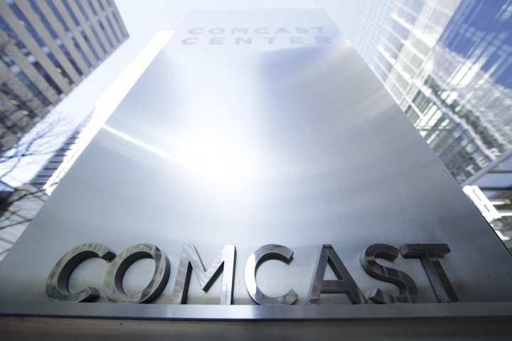 This March 29, 2017, photo shows a sign outside the Comcast Center in Philadelphia. Comcast will start selling cellphone plans called Xfinity Mobile in the coming months, using a network it's leasing from Verizon. Many subscribers will save money, especially if they don't use a lot of data. The catch: Only Comcast internet customers can sign up. (AP Photo/Matt Rourke)