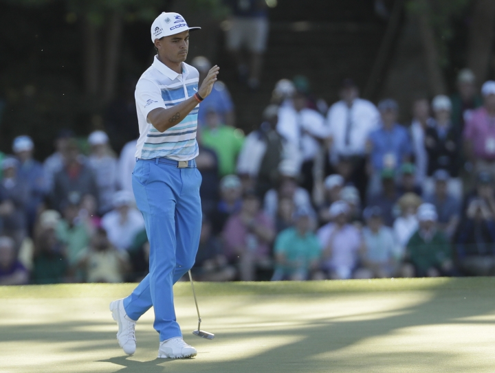 Rickie Fowler reacts after a birdie on the 15th hole during the third round of the Masters golf tournament Saturday, April 8, 2017, in Augusta, Ga. (AP Photo/David J. Phillip)