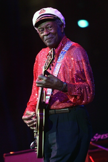 FILE - In this Saturday, May 30, 2009 file photo, Chuck Berry performs at The Domino Effect, a tribute concert to New Orleans rock and roll musician Fats Domino, at the New Orleans Arena in New Orleans. Fans can file past Berry's casket later Sunday, April 9, 2017, at a St. Louis club where he often performed. After the public viewing, a private service will be held for family and friends of the music legend, who died March 18 at age 90. (AP Photo/Patrick Semansky)
