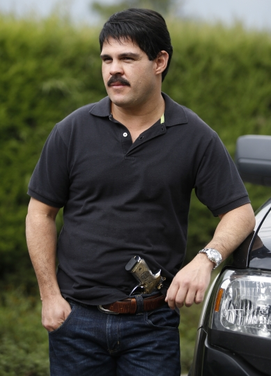 "In this March, 21, 2017 photo, Mexican actor Marco de la O relaxes during a pause in the filming of the TV series about the life Mexico's drug lord Joaquin Guzman, in Tabio, Colombia. While the real Joaquin ""El Chapo"" Guzman is locked up in a cold, tiny cell in New York, his career as a drug lord apparently over, his fictional counterpart rides free at the top of his form in Colombia, where the Univision network and Netflix are filming a television series about his life. (AP Photo/Fernando Vergara)"
