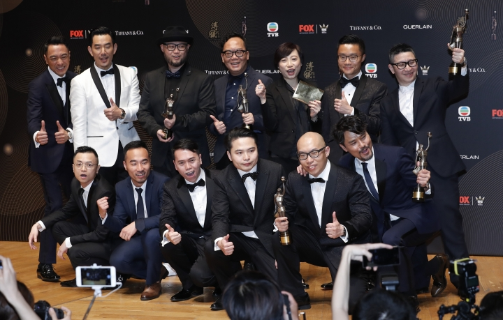 "The crew of movie ""Trivisa"" celebrate after winning the Best Actor and Best Film awards during the Hong Kong Film Awards in Hong Kong, Sunday, April 9, 2017. (AP Photo/Kin Cheung)"