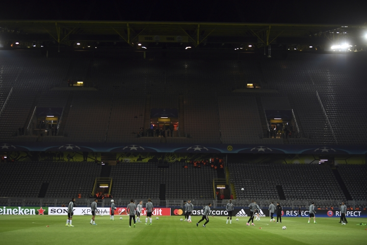 Monaco players train in the empty Signal Iduna Park in Dortmund, Germany, Tuesday, April 11. The first leg of the Champions League quarter final soccer match between Borussia Dortmund and AS Monaco had been cancelled to an explosion. (AP Photo/Federico Gambarini/dpa via AP)