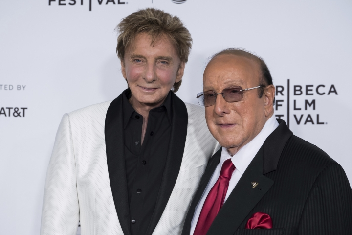 """Barry Manilow, left, and Clive Davis attend the world premiere of """"Clive Davis: The Soundtrack of Our Lives"""" at Radio City Music Hall, during the 2017 Tribeca Film Festival, Wednesday, April 19, 2017, in New York. (Photo by Charles Sykes/Invision/AP)"""