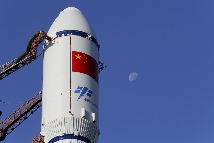 In this Monday, April 17, 2017 photo released by China's Xinhua News Agency, a Long March 7 rocket carrying the Tianzhou 1 is transferred to the launching site in Wenchang, south China's Hainan Province. China is preparing to launch its first unmanned cargo spacecraft on a mission to dock with the country's space station. The Tianzhou 1 was due to blast off at 7:41 p.m. (1141 GMT) Thursday atop a latest-generation Long March 7 rocket from China's newest spacecraft launch site. (Ju Zhenhua/Xinhua via AP)
