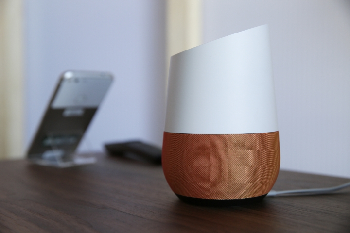 FILE - In this Tuesday, Oct. 4, 2016, file photo, Google Home, right, sits on display near a Pixel phone following a product event, in San Francisco. Google's voice-activated assistant can now recognize who's talking to it on the Google's Home speaker. An update coming out Thursday, April 20, 2017, will enable Home's built-in assistant to learn the different voices of up to six people, although they can't all be talking to the internet-connected speaker at the same time. The feature will allow Home to be more personal in some responses and give it a potential advantage over Amazon.com's Echo. (AP Photo/Eric Risberg, File)