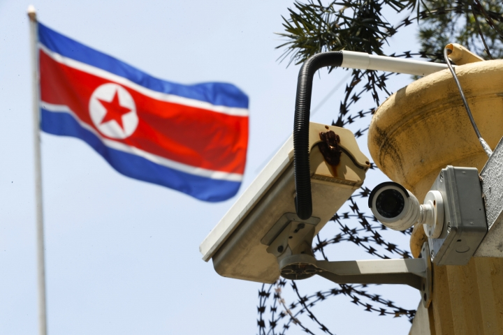 FILE - In this March 13, 2017 file photo, a CCTV surveillance camera attached by the entrance gate at the North Korean Embassy monitors passersby in Kuala Lumpur, Malaysia. In the paranoid universe of North Korea, the feverish accusations it makes against its sworn enemies bear a creepy resemblance to its own misdeeds. Its latest claim of a South Korean and American plot to assassinate Kim Jong Un using biochemical weapons comes weeks after the North Korean leader's estranged brother, Kim Jong Nam, was slain in a Malaysian airport. Authorities cited the presence of VX nerve agent, and North Korea is widely believed to have been behind responsible. (AP Photo/Vincent Thian, File)