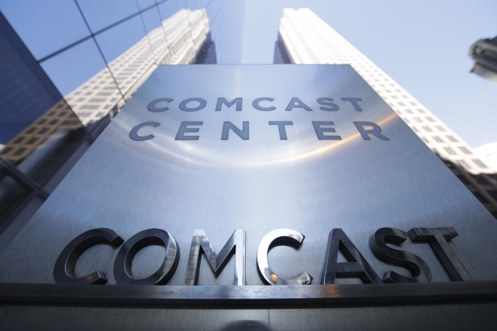 FILE - This Wednesday, March 29, 2017, file photo shows a sign outside the Comcast Center in Philadelphia. Cable operators Comcast and Charter Communications have agreed to form a wireless partnership in order to strengthen their positions in the rapidly growing sector. Comcast and Charter Communications Inc. said Monday, May 8, that their partnership will give customers more choice and competitive prices. (AP Photo/Matt Rourke, File)