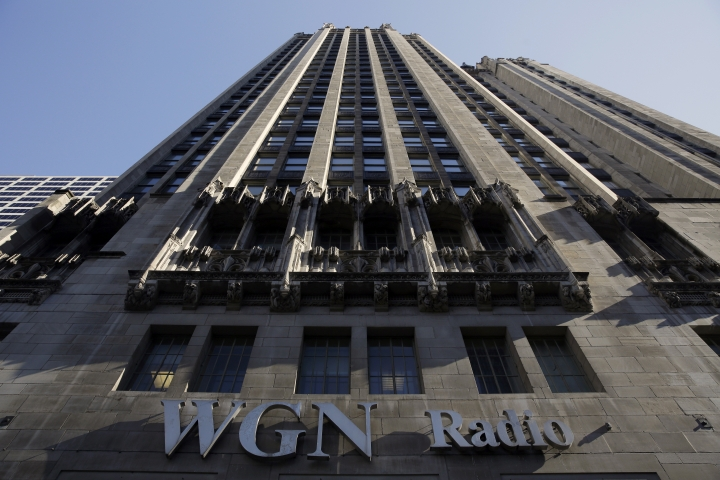 FILE - In this Monday, May 1, 2017, file photo, the WGN Radio sign appears on the side of Tribune Tower, in downtown Chicago. Sinclair Broadcast Group, one of the nation's largest local TV station operators, announced Monday, May 8, 2017, that it will pay about $3.9 billion for Tribune Media, adding more than 40 stations including KTLA in Los Angeles, WPIX in New York and WGN in Chicago. (AP Photo/Kiichiro Sato, File)