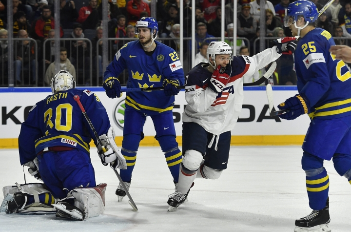 US forward J.T. Compher celebrates after scoring the 4-3 during the Ice Hockey World Championships group A match between USA and Sweden at the LANXESS arena in Cologne, Germany, Monday, May 8, 2017. (AP Photo/Martin Meissner)