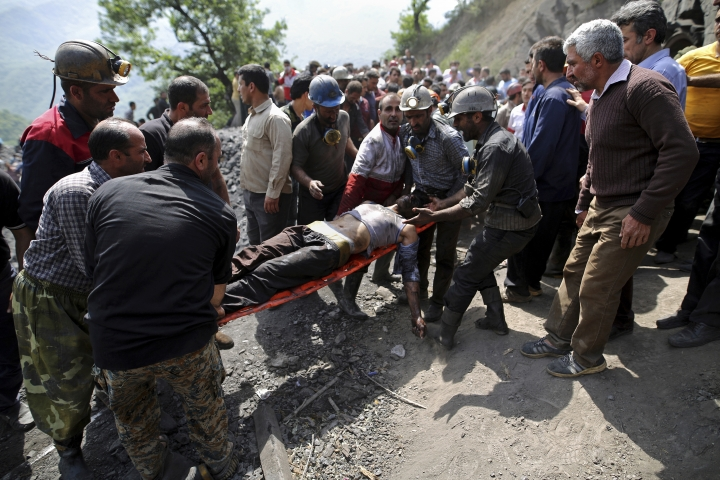 FILE --In this Wednesday, May, 3, 2017 file photo, released by the Tasnim News Agency, miners and rescue personnel carry an injured mine worker after a coal mine explosion, at the Zemestanyourt mine, near Azadshahr, in northern Iran. State TV said Tuesday, May 9, 2017, that search crews have found seven more bodies at the site of the coal mine explosion last week, bringing the total death toll in the incident to 42. Tuesday's report quoted Reza Morovati, an official in the Golestan government, as saying it's possible that one miner remains trapped inside the coal mine. (AP Photo/Tasnim News Agency, Mostafa Hassanzadeh, File)