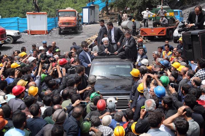 In this photo released by an official website of the office of the Iranian Presidency, Iranian President Hassan Rouhani, center, addresses coal miners during his visit to the site of a deadly mine explosion in Zemestanyourt mine, near Azadshar, northern Iran, Sunday, May 7, 2017. Angry coal miners besieged a car carrying Iranian President Hassan Rouhani on Sunday after he visited the site of a deadly mine explosion, a rare protest targeting the nation's top elected official as he campaigns for re-election. (Iranian Presidency Office via AP)