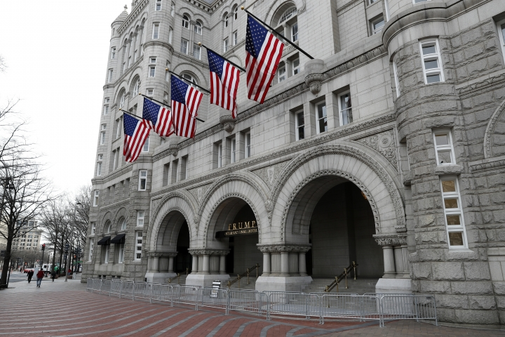 In this photo taken Dec. 21, 2016, the Trump International Hotel in Washington. The number of U.S. tourists visiting Washington reached 20 million for the first time in 2016, thanks in part by a high-profile new museum on the National Mall, the city's tourism bureau announced. (AP Photo/Alex Brandon)
