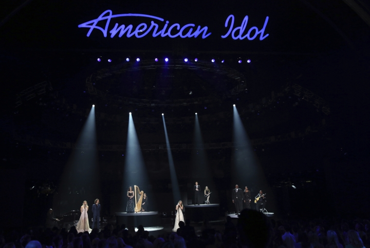 """FILE - In this Thursday, April 7, 2016, file photo, Katherine McPhee, from left, Casey James, Carly Smithson, Jessica Sanchez, Clay Aiken, Ruben Studdard and Amber Holcomb perform at the """"American Idol"""" farewell season finale at the Dolby Theatre in Los Angeles. ABC said Tuesday, May 9, 2017, it will revive """"American Idol"""" after it has spent only one year off the air. (Photo by Matt Sayles/Invision/AP, File)"""