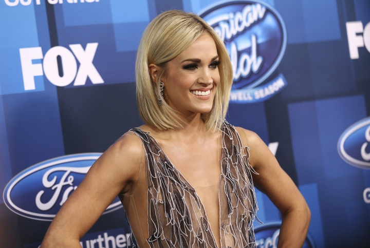 """FILE - In this Thursday, April 7, 2016, file photo, Carrie Underwood arrives at the """"American Idol"""" farewell season finale at the Dolby Theatre in Los Angeles. ABC said it will revive """"American Idol"""" after it has spent only one year off the air. The network announced Tuesday, May 9, 2017, that the music competition show that dominated television in the 2000s and minted stars like Underwood, Jennifer Hudson and Kelly Clarkson, will begin sometime in the next TV season. That season starts in September 2017. (Photo by John Salangsang/Invision/AP, File)"""