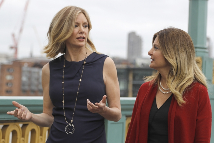 TV presenter Wendy Walsh speaks to her lawyer Lisa Bloom, right, in London, Tuesday, May 9, 2017. Wendy Walsh is one of the women who has accused former Fox News presenter Bill O'Reilly of sexual harassment. A U.K. scandal torpedoed Rupert Murdoch's first attempt to take control of British-based broadcaster Sky. Now claims of sexual harassment at his U.S.-based Fox News are creating storm clouds around a second. Walsh is calling on British regulators to reject 21st Century Fox's bid to buy the 61 percent of Sky that it doesn't already own, saying the deal would allow Fox to bring a culture of sexual and racial harassment to the U.K. (AP Photo/Frank Augstein)