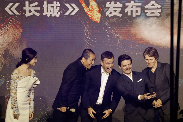 "FILE - In this Dec. 6, 2016 file photo, actors from right, Willem Dafoe, Pedro Pascal, Matt Damon, movie director Zhang Yimou and actress Jing Tian pose for a selfie on stage upon arrival for a news conference for the movie ""The Great Wall"" at a hotel in Beijing. During an interview on Tuesday, May 9, 2017, Zhang said the disappointing U.S. performance of the biggest budget China-U.S. co-production to date, ""The Great Wall,"" may have been down to a weak story. Nevertheless, Zhang called the fantasy epic a ""first step"" in such collaborations and hoped filmmakers wouldn't be put off. (AP Photo/Andy Wong, File)"