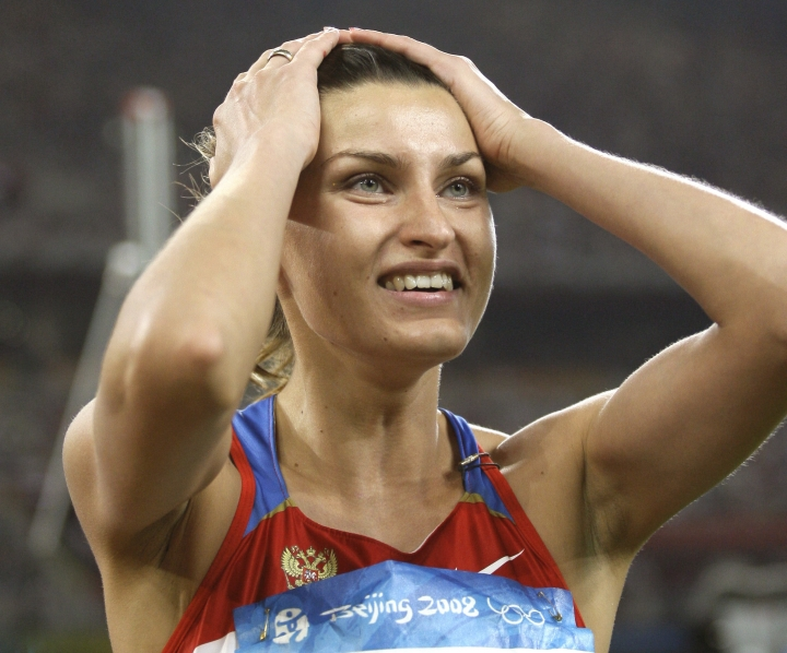 FILE - In this Aug. 23, 2008 file photo Russia's Anna Chicherova reacts after making a clearance in the final of the women's high jump during the athletics competitions in the National Stadium at the Beijing 2008 Olympics in Beijing. Three Russian Olympic medalists have appeal hearings in doping cases at the Court of Arbitration for Sport this month. CAS says high jumper Anna Chicherova's appeal is May 30-31 2017 to challenge the IOC stripping her 2008 Beijing Olympics bronze medal. (AP Photo/David J. Phillip, file)