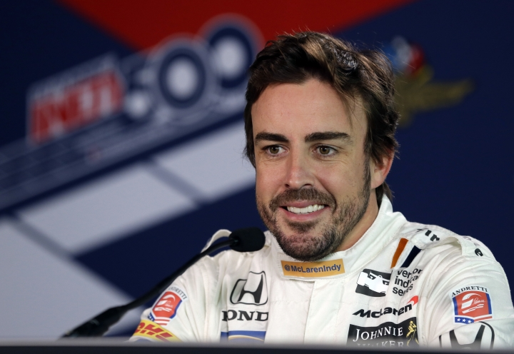 FILE - In this May 3, 2017, file photo, Fernando Alonso, of Spain, talks about practicing for the first time at Indianapolis Motor Speedway in Indianapolis. Indianapolis 500 organizers spent last May showcasing their 100th race. The payoff may come this month. With bustling ticket sales, a two-time Formula One champion trying to make the 33-car starting grid and a perfect blend of rising stars and old fan favorites, Indianapolis Motor Speedway President Doug Boles couldn't be happier. (AP Photo/Michael Conroy, File)
