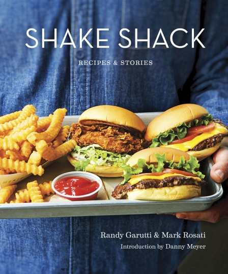 "This image provided by Penguin Random House shows the cover of the book ""Shake Shack: Recipes & Stories."" The book was co-written by Shake Shack's CEO, Randy Garutti, and culinary director Mark Rosati. (Penguin Random House via AP)"
