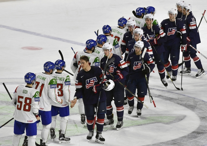 US forward Anders Lee, center, leads the team on the ice after winning the Ice Hockey World Championships group A match between USA and Italy at the LANXESS arena in Cologne, Germany, Wednesday, May 10, 2017. USA won the match with 3-0. (AP Photo/Martin Meissner)