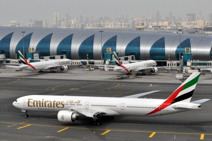 FILE -- In this March 22, 2017 file photo, an Emirates plane taxis to a gate at Dubai International Airport at Dubai International Airport in Dubai, United Arab Emirates. Emirates Group, which operates the Middle East's largest airline, said in a report released Thursday, May 11, 2017, that profits have fallen by 70 percent to $670 million, though revenue increased slightly to around $26 billion. The airline said profits were affected by a turbulent year, including heightened immigration concerns, terror attacks in several European cities, an attempted military coup in Turkey and uncertainty caused by Britain's vote to leave the European Union. (AP Photo/Adam Schreck, File)