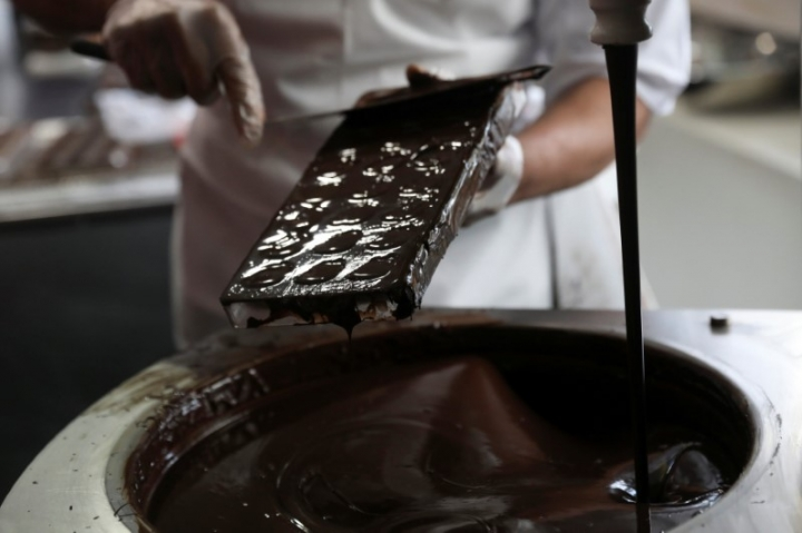 A man gives a chocolate demonstration inside The Chocolate Museum in New York, U.S., May 10, 2017. REUTERS/Shannon Stapleton