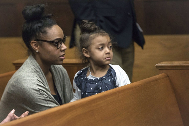 "FILE - In this Wednesday, April 12, 2017, file photo, Shayanna Jenkins Hernandez, fiancee of former New England Patriots tight end Aaron Hernandez, sits in the courtroom with the couple's daughter during jury deliberations in Hernandez's double-murder trial at Suffolk Superior Court in Boston. Jenkins-Hernandez said in an interview on ""Dr. Phil"" scheduled to air May 2017 that she thought ""some cruel person"" was playing a trick on her when she heard Hernandez hand hanged himself in his prison cell on April 19, days after he was acquitted of a double murder. He was still serving a life sentence for another killing. (Keith Bedford/The Boston Globe via AP, Pool, File)"