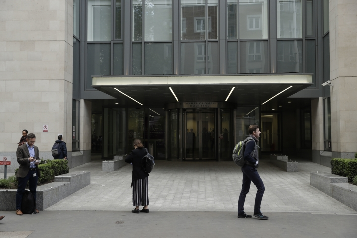 An exterior view shows the main entrance of St Bartholomew's Hospital, in London, one of the hospitals whose computer systems were affected by a cyberattack, Friday, May 12, 2017. A large cyberattack crippled computer systems at hospitals across England on Friday, with appointments canceled, phone lines down and patients turned away. (AP Photo/Matt Dunham)