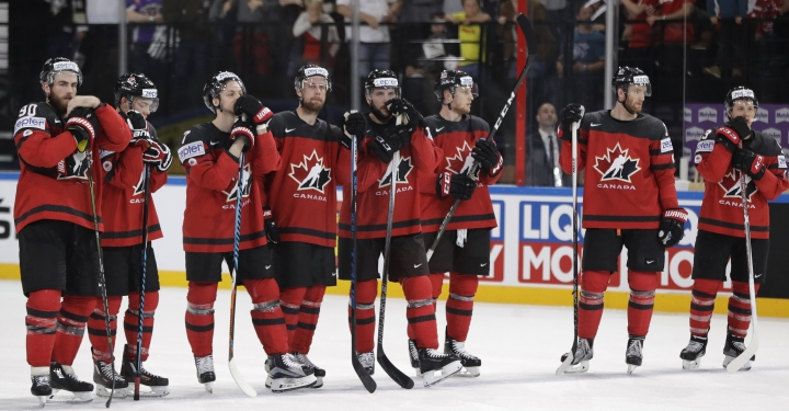 Canada's players stand on ice after the Ice Hockey World Championships group B match between Canada and Switzerland in the AccorHotels Arena in Paris, France, Saturday, May 13, 2017. (AP Photo/Petr David Josek)