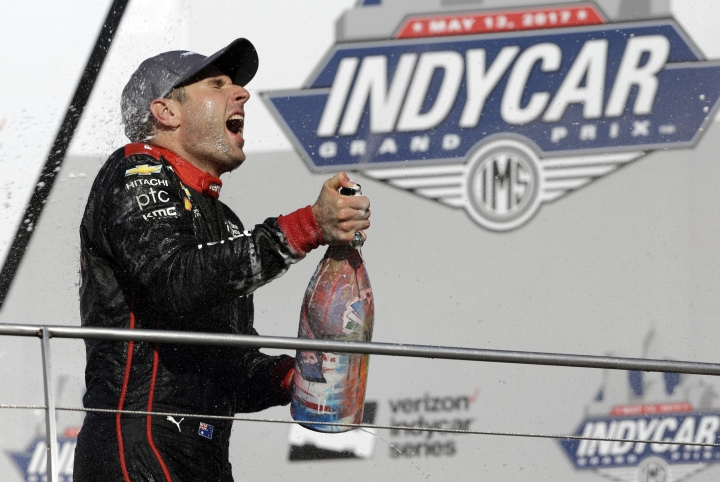 Will Power, of Australia, celebrates after winning the Grand Prix of Indianapolis IndyCar auto race at Indianapolis Motor Speedway, Saturday, May 13, 2017, in Indianapolis. (AP Photo/Michael Conroy)