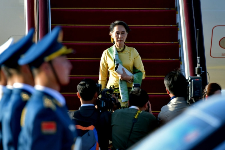 Myanmar's State Counsellor Aung San Suu Kyi arrives at Beijing Capital International Airport for the Belt and Road Forum in Beijing, China, May 13, 2017. Picture taken May 13, 2017. REUTERS/Stringer