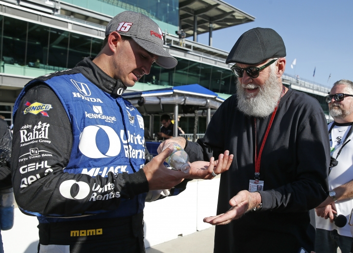 Graham Rahal, left, shows David Letterman the blisters on his hand following the Grand Prix of Indianapolis IndyCar auto race at Indianapolis Motor Speedway, Saturday, May 13, 2017, in Indianapolis. (AP Photo/Rob Baker)