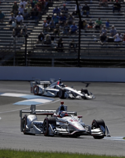 Will Power, of Australia, (12) leads Helio Castroneves, of Brazil, during the Grand Prix of Indianapolis IndyCar auto race at Indianapolis Motor Speedway, Saturday, May 13, 2017, in Indianapolis. (AP Photo/Michael Conroy)
