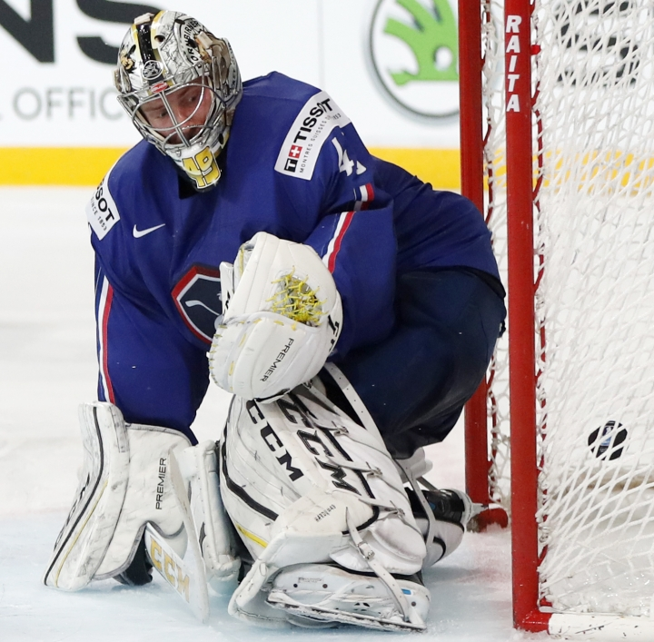 France's Florian Hardy fails to make a save during the Ice Hockey World Championships group B match between France and Czech Republic in the AccorHotels Arena in Paris, France, Sunday, May 14, 2017. (AP Photo/Petr David Josek)