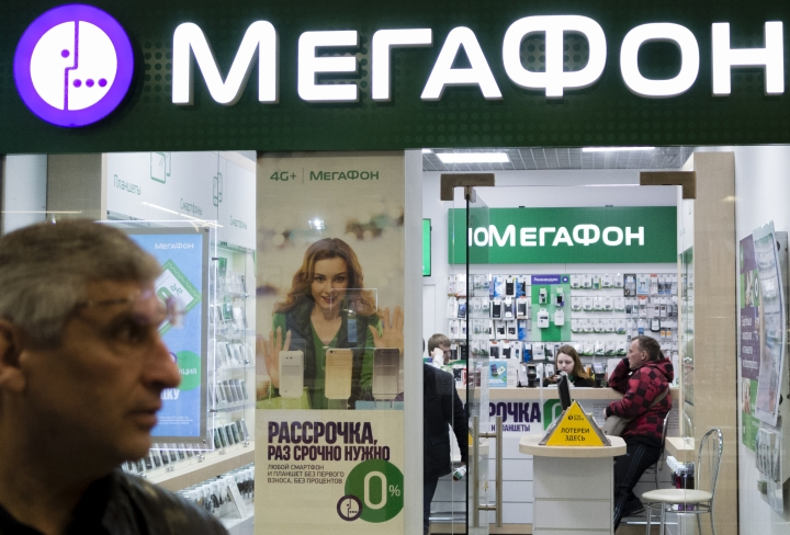 People inside a Megafon mobile phones shop in Moscow, Russia, Saturday, May 13, 2017. A top Russian mobile operator said Friday it had come under cyberattacks that appeared similar to those that have crippled some U.K. hospitals. Pyotr Lidov, a spokesman for Megafon, said Friday's attacks froze computers in company's offices across Russia. (AP Photo/Ivan Sekretarev)