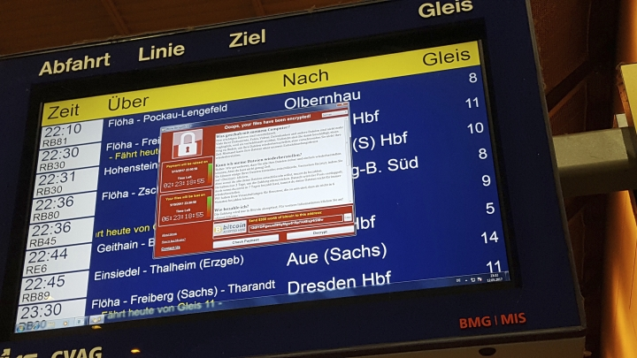 In this May 12, 2017 photo, a display panel with an error can be seen at the main railway station in Chemnitz, Germany. Germany's national railway says that it was among the organizations affected by the global cyberattack but there was no impact on train services. Deutsche Bahn said early Saturday that departure and arrival display screens at its stations were hit Friday night by the attack. (P. Goezelt/dpa via AP)