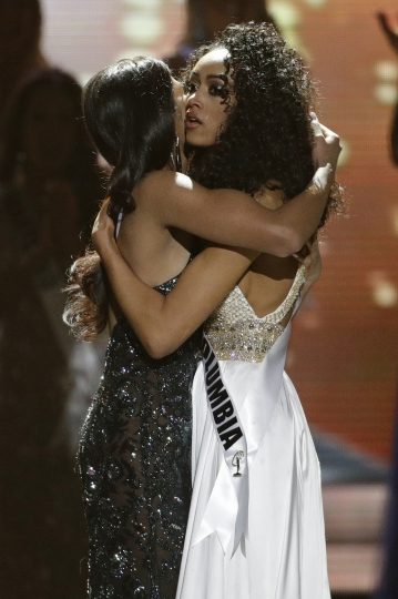 Miss District of Columbia USA and new Miss USA Kara McCullough, right, embraces first runner up Miss New Jersey USA Chhavi Verg during the Miss USA contest Sunday, May 14, 2017, in Las Vegas. (AP Photo/John Locher)