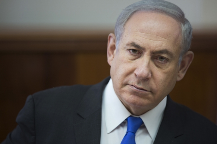 FILE - In this Sunday, May 7, 2017 file photo, Israeli Prime Minister Benjamin Netanyahu chairs a weekly cabinet meeting at his office in Jerusalem. The Israeli prime minister's office says it is seeking clarifications from President Donald Trump after an American official said the Western Wall is part of the West Bank. The spat reportedly erupted during preparations for Trump's visit to the region next week. (AP Photo/Oded Balilty, Pool)