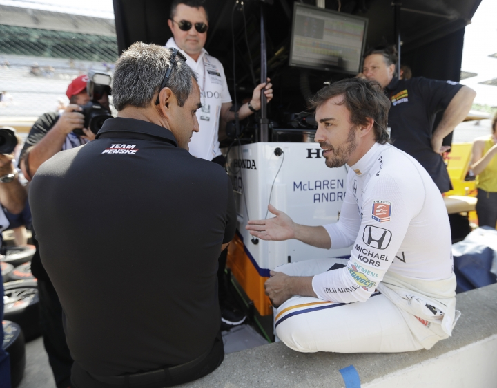 Fernando Alonso, of Spain, right, talks with Juan Pablo Montoya, of Colombia, during a practice session for the Indianapolis 500 IndyCar auto race at Indianapolis Motor Speedway, Monday, May 15, 2017 in Indianapolis. (AP Photo/Darron Cummings)