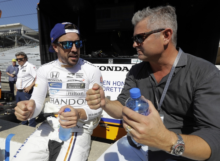 Fernando Alonso, left, of Spain, talks with Gil de Ferran during a practice session for the Indianapolis 500 IndyCar auto race at Indianapolis Motor Speedway, Monday, May 15, 2017, in Indianapolis. (AP Photo/Darron Cummings)