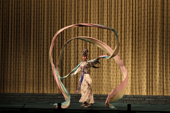 In this Saturday, May 13, 2017, photo, a performer of Peking Opera takes to the stage at a theater in Beijing. Performers in the Peking style of Chinese opera sing, dance and do acrobatics and martial arts. (AP Photo/Louise Watt)