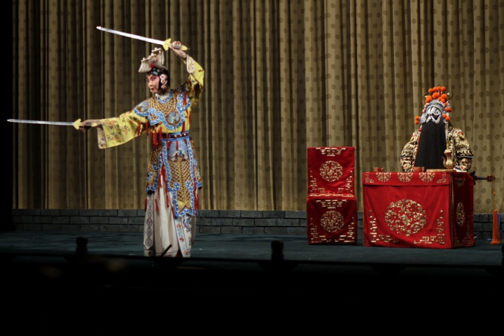 """In this Saturday, May 13, 2017, photo, Zhao Hailong, right, performs the lead in the Peking Opera classic """"Farewell My Concubine"""" at a theater in Beijing, along with Shang Wei. When Zhao Hailong was a teenager he played a small role in the award-winning film """"Farewell My Concubine,"""" the story of the friendship between two men who met as apprentices in the Peking Opera. Today, he is the lead on stage in the Peking Opera classic of the same name. (AP Photo/Louise Watt)"""