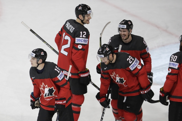 Canada's Mitch Marner, left, celebrates with teammates after scoring his sides third goal during the Ice Hockey World Championships group B match between Canada and Finland in the AccorHotels Arena in Paris, France, Tuesday, May 16, 2017. (AP Photo/Petr David Josek)